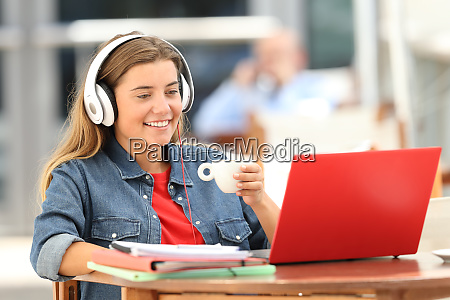 relaxed student watching media on line