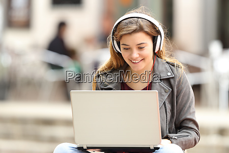 girl listening and downloading music from