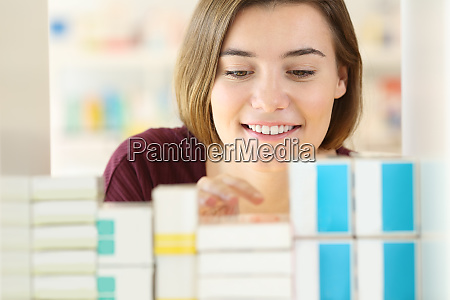 customer searching medicines in a pharmacy