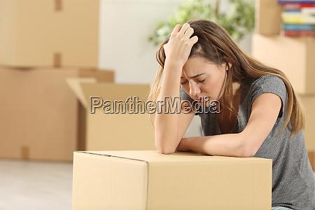 sad homeowner moving home after eviction