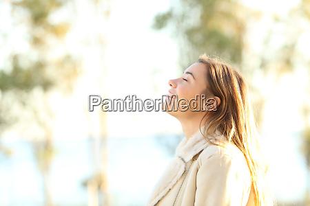 teen breathing fresh air outdoors
