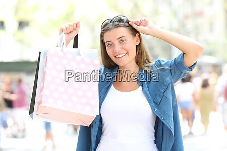 shopper showing blank shopping bags in