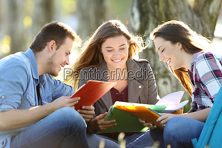 three students learning reading notes