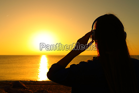 woman listening chill out music at