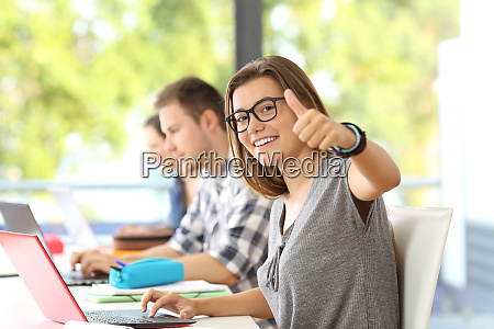 happy student wearing eyeglasses posing