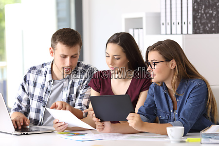 employees coworking on line at office
