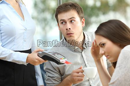 boyfriend looking at waiter chest
