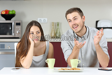 bored wife hearing her husband talking
