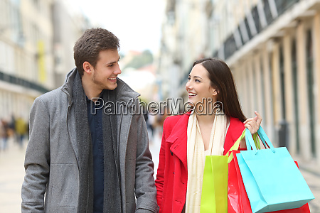 couple of shoppers talking and walking