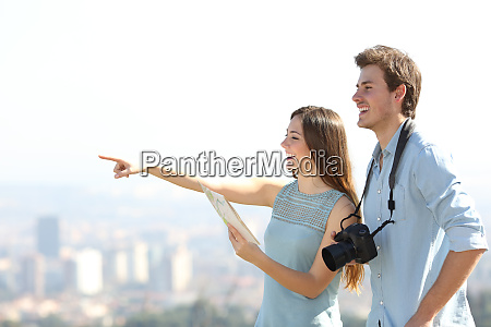 happy tourists sightseeing in a city