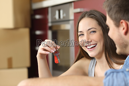 happy new flat owners showing keys