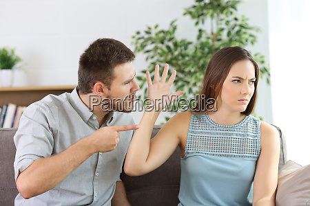 angry couple fighting on a couch