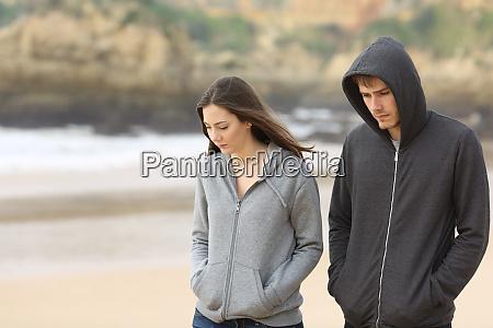 couple of teenagers walking sad