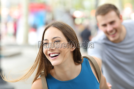 funny couple of teenagers running on