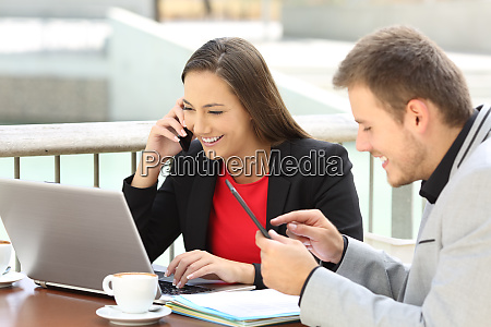 two executives calling and working together