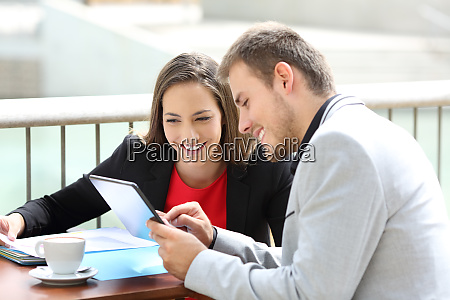 two executives consulting on line data