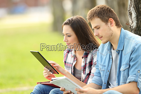 two students studying on line and