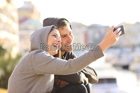 couple of teens taking a selfie