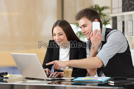 coworkers working together online