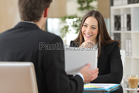 salesman showing product to a client