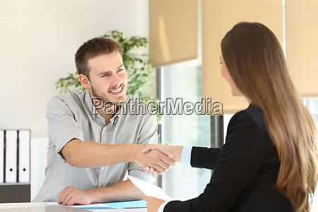 employee and boss handshaking after a