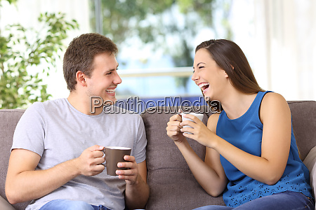 two people talking and laughing at