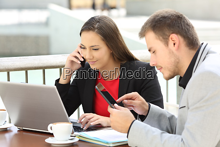 executives coworking in a coffee shop