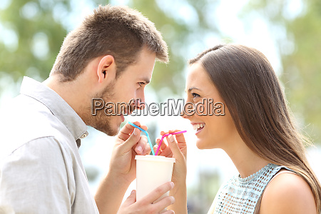 couple in love sharing a drink