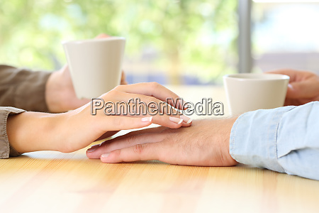 couple dating and touching hands