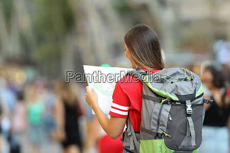teen tourist searching location in a