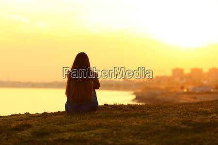 woman seeing a sunset on the