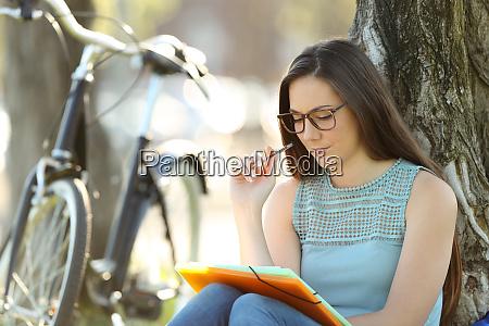 student memorizing wearing eyeglasses