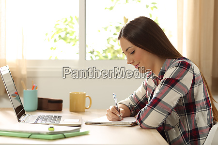 student studying and taking notes at