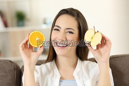 woman showing half apple and half