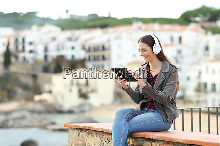 happy woman watching media on a