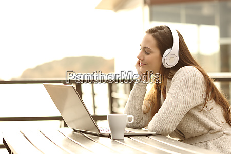 girl listening music and relaxing