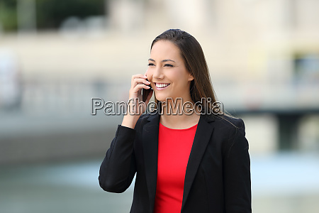 smiley executive talking on phone in