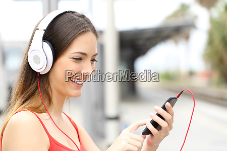 woman listening and choosing music in