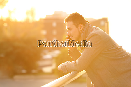 man talking on phone in a