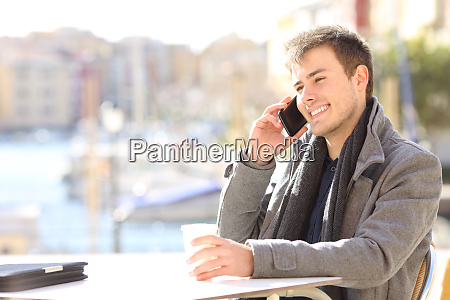 man takls on phone in winter
