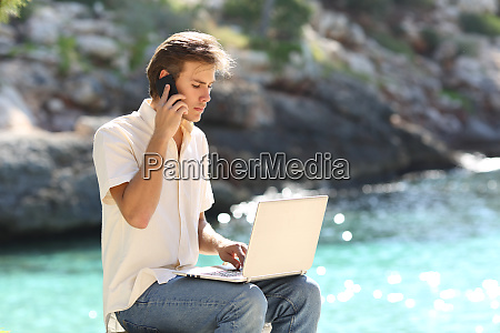 customer calling on phone consulting laptop