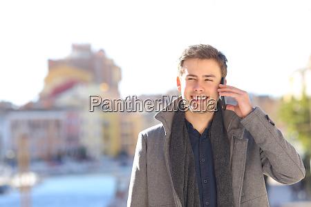 happy man talking in phone in