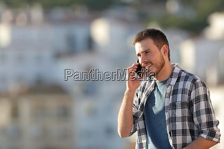 happy man talking on phone at