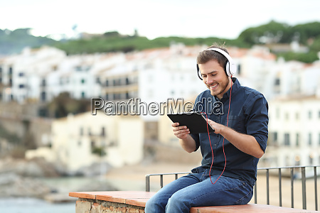 happy man watching media on a