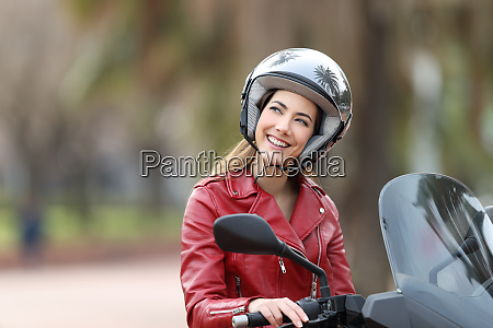 happy biker on a motorbike dreaming