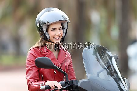 happy biker on a motorbike looking