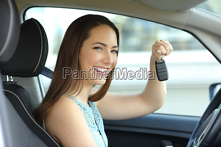 happy car owner holding keys looking