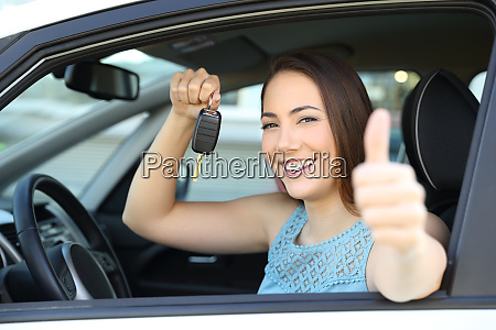 happy car owner with a key