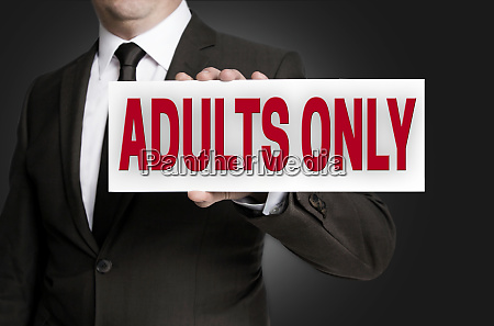 adults only sign held by businessman
