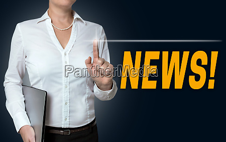 news touchscreen is operated by businesswoman